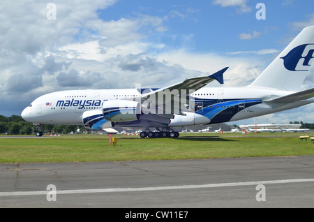 Airbus A380 in the colours of Malaysia Airlines beginning its take-off run at Farnborough International Airshow - Stock Photo