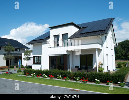 Modern highly energy efficient family house with solar panels on roof in Germany - Stock Photo