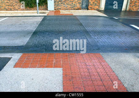 Road marking with feature for blind people at pedestrian crossing. UK. - Stock Photo