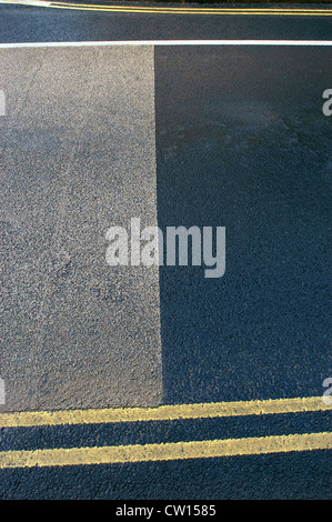 Coloured asphalt and yellow lines. - Stock Photo