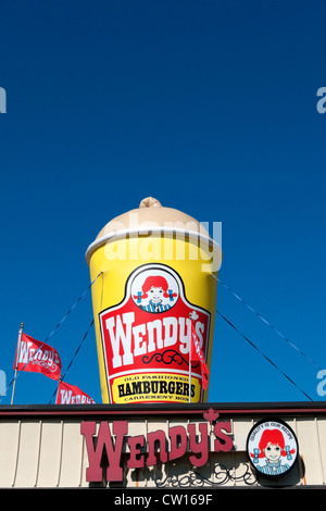 Advertising signs for Wendy's fast food hamburger milkshake restaurant Fort Erie, Ontario, Canada - Stock Photo
