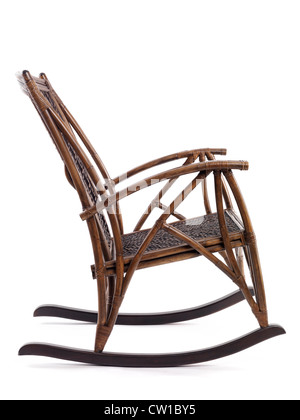 Antique wooden rocking chair side view isolated on white background - Stock Photo