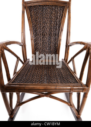 Abstract closeup of antique bamboo wicker rocking chair isolated on white background - Stock Photo