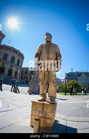 A man dressed up as a statue outside the Parlament of Norway in Oslo - Stock Photo