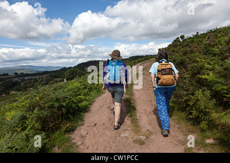Two female walkers on track to Sugar Loaf mountain, Abergavenny, Wales, UK - Stock Photo