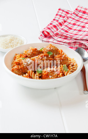 A bowl of meatballs with fusili pasta and tomato sauce, or marinara. Meatballs are made from turkey mince. - Stock Photo