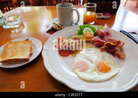 american breakfast on a table in Thai cafe - Stock Photo