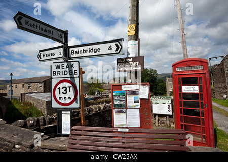 Notice Board and Signs in Gayle, Wensleydale, North Yorkshire Dales National Park, Hawes, UK - Stock Photo
