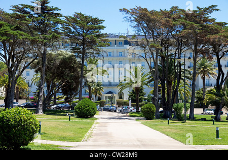 Central park gardens and famous Hotel Palacio Estoril (1930), Estoril, Lisbon Coast,  Estremadura, Portugal. - Stock Photo