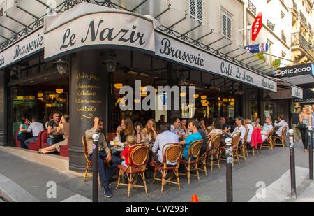 Paris, France, Crowd People in Abesses Montmartre Area, French Brasserie, Café Restaurants 'Le Nazir' Parisian street - Stock Photo