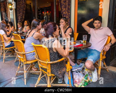 Paris, Cafe France, Crowd Young French People Sharing Drinks in Abesses Montmartre Area, French Bistro Restaurant - Stock Photo