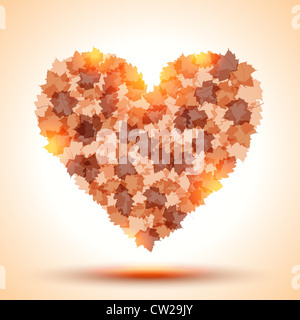 Heart shape from autumn leaves - Stock Photo