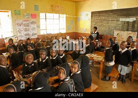 Young Kenyan children in school classroom - Stock Photo