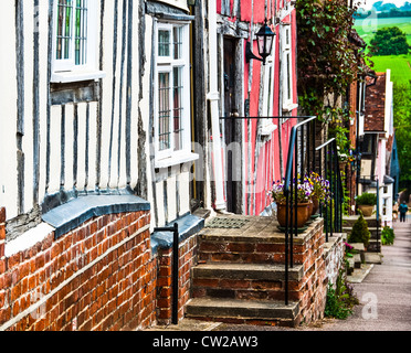 A row of colorful old town houses in Lavenham, England - Stock Photo