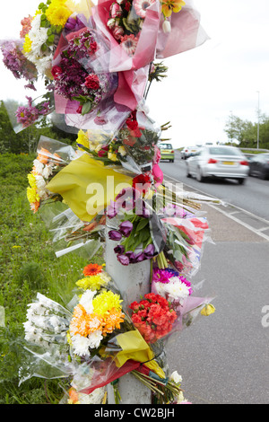 Floral Tributes At Site Of Fatal Traffic Accident - Stock Photo