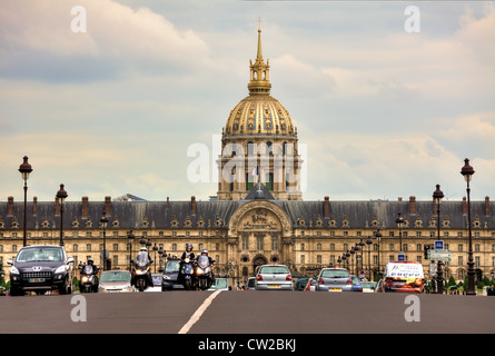 Traffic on Alexander III bridge near Les Invalides complex in Paris, France. - Stock Photo