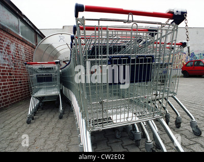 Berlin, in front of a cart ALDI - Stock Photo