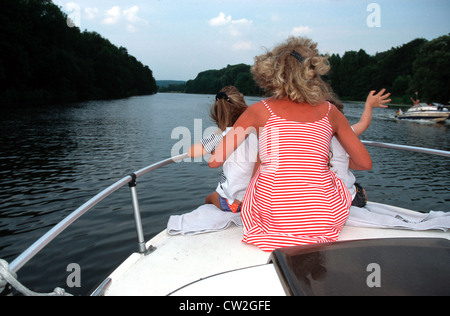 Family leisure, boating on the Ruhr in Essen - Stock Photo