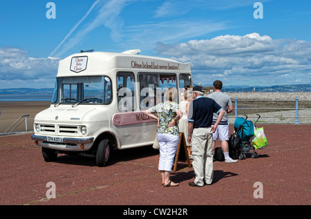 People buying ice creams from an ice cream van on the promenade in Morecambe, Lancashire - Stock Photo