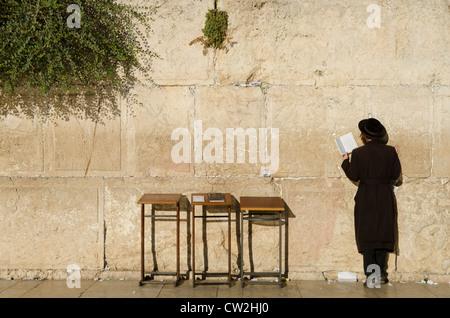Orthodox Jew praying at the Western Wall. Jerusalem Old City. Israel. - Stock Photo