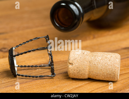 Champagne style cork and retaining cap by brown bottle of strong belgium ale beer - Stock Photo