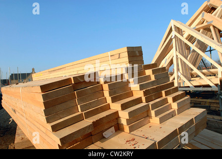 Timber planks and roof trusses on housing development site. - Stock Photo