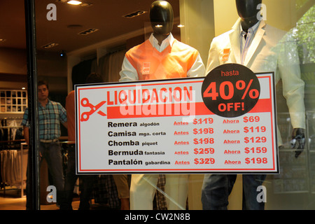 Mendoza Argentina Avenida San Martin shopping store window business boutique mannequin men's apparel clothing sign - Stock Photo