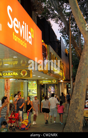 Mendoza Argentina Avenida San Martin street scene commercial district busy avenue sidewalk nightlife shopping pedestrian - Stock Photo