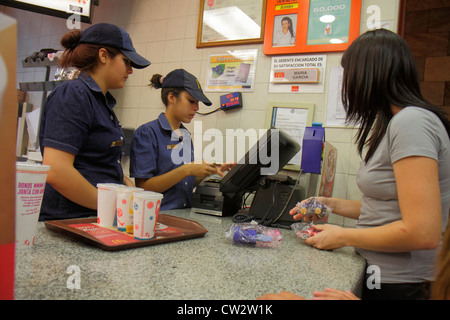 Mendoza Argentina Avenida San Martin McDonald's fast food restaurant business global company counter Hispanic woman - Stock Photo