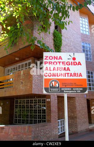 Mendoza Argentina Avenida Emilio Civit neighborhood watch security community alarm sign Spanish language public - Stock Photo