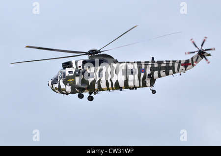 Westland Sea King HC4 in arctic camouflage operated by 848  Squadron, Commando Helicopter Force, departing RAf Fairford - Stock Photo