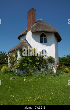 This funny little thatched cottage at Stanton Drew in Somerset is called The Round House, it used to be a turnpike - Stock Photo