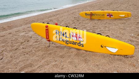 Two RNLI Lifeguard surfboards on Blackpool Sands beach near Stoke Fleming in Devon. - Stock Photo