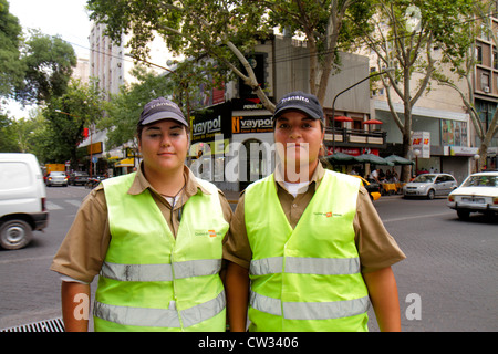 Mendoza Argentina Avenida San Martin Hispanic woman women public safety traffic agent inspector job uniform reflective - Stock Photo