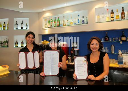 Buenos Aires Argentina Avenida de Mayo Japanese restaurant bar business Hispanic woman young adult bartender waitress - Stock Photo