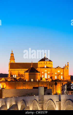 Cordoba Spain Cordoba Cathedral Great Mosque Mezquita Mesquita World Heritage Site Roman Bridge at dusk  Andalusia - Stock Photo