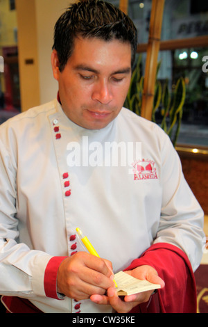 Buenos Aires Argentina Avenida de Mayo Pizza & Cafe Alameda restaurant dining Hispanic man dining waiter job uniform - Stock Photo