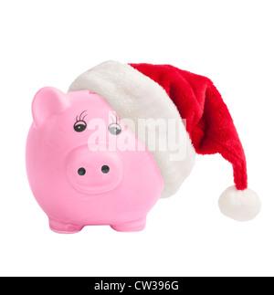 Piggy bank wearing a santa hat - Christmas savings concept - Stock Photo