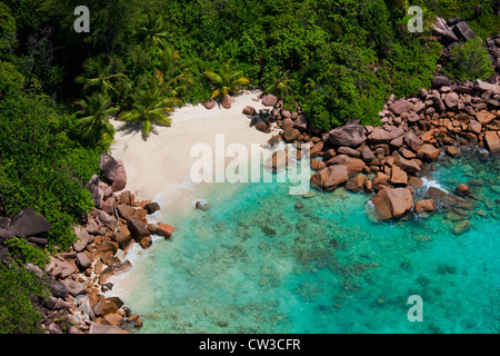 Aerial view of a secluded beach, coast of Praslin.Seychelles - Stock Photo