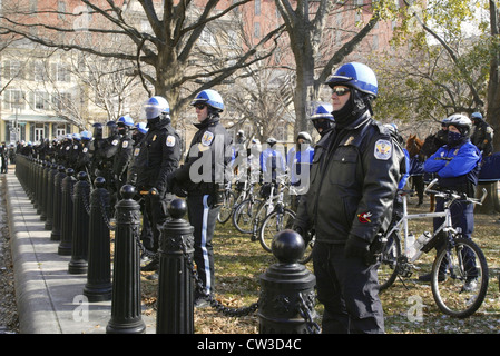 Members of the US Park Police stand guard outside of Pershing Park near the White House during a large anti war - Stock Photo