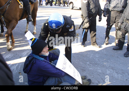 A US Park Police officer scolds a man while clearing the streets of protesters outside of Pershing Park near the - Stock Photo