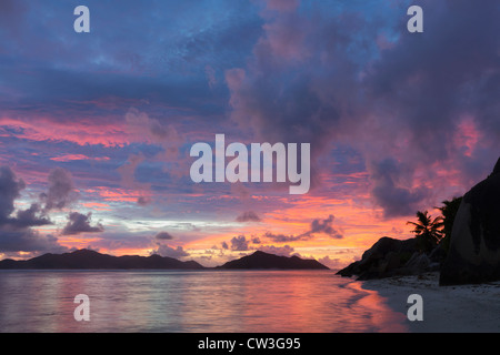 View of beach at sunset with granite boulders.La Digue Island. Seychelles. - Stock Photo