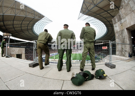 Berlin police exercise control over a football match in Berlin's Olympic Stadium - Stock Photo