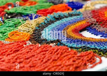 Ecuador, Quito area, Otavalo Handicraft Market. Typical colorful beaded souvenir necklaces. - Stock Photo