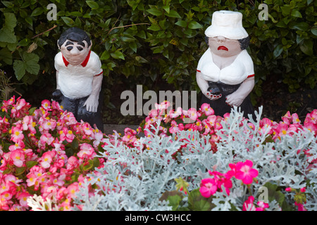 Bowlers Garden Ornaments Positioned In Flower Bed At Bowling Club   Stock  Photo