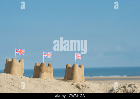 Union Jack flags in sandcastles on a sand dune. Wells next the sea. Norfolk, England - Stock Photo
