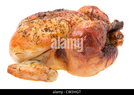 A ready to eat freshly roasted chicken - studio shot with a white background - Stock Photo