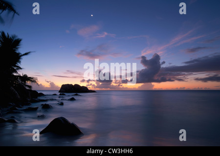 Sunset over beach.Cousine Island.Seychelles - Stock Photo