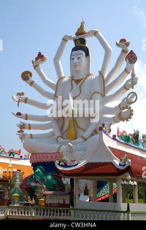 18 arm Buddha statue at Wat Plai Laem temple located on the island of Ko Samui, Thailand. - Stock Photo