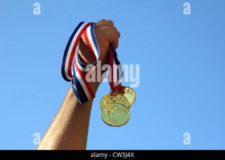 Gold medal winner - Stock Photo